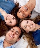 Friends with heads together Stock Photography
