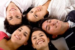 Friends with heads together Royalty Free Stock Photo