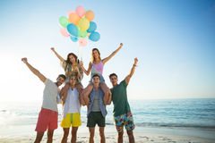 Friends with helium balloons at beac Stock Photo