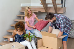 Friends helping in relocating at new house Royalty Free Stock Photos