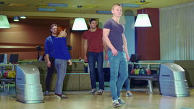 Friends high-fives man after his release at the bowling stock video