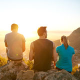 Friends on a hike enjoying the sunrise together Stock Photo