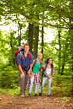Friends hiking through the forest Royalty Free Stock Images