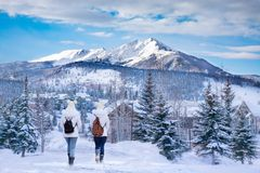 Friends hiking in the muntains on winter break. Friends with backpacks hiking in the muntains. Girls enjoying beautiful Colorado mountain town on winter break stock image