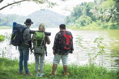 Friends hiking in outdoor summer activity. With backpack, people backpackers enjoying beautiful nature landscape Royalty Free Stock Photo