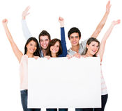 Friends holding a bannner Royalty Free Stock Images