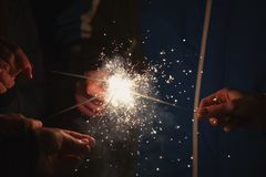 Friends holding beautiful sparklers in celebration of the new year.  Stock Images