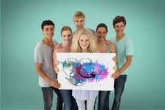 Friends holding billboard with colorful diagram while standing against green background. Digital composite of Friends holding billboard with colorful diagram Stock Photos