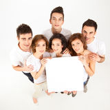 Friends holding blank banner Stock Image