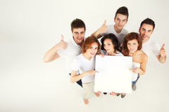 Friends holding blank banner Stock Images