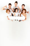 Friends holding blank banner Royalty Free Stock Photography