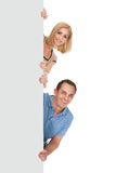 Friends holding blank placard Stock Images