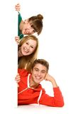 Friends holding blank poster Royalty Free Stock Photography