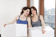 Friends holding boxes Royalty Free Stock Photo