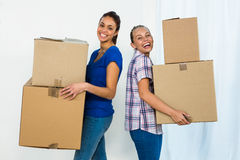 Friends holding boxes stock image