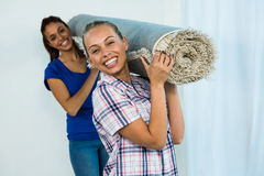 Friends holding a carpet Stock Images