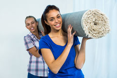 Friends holding a carpet royalty free stock photography