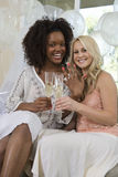 Friends Holding Champagne Flute And Showing Nail Polish Stock Images
