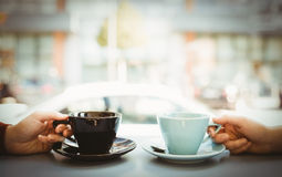 Friends holding cup of coffee Royalty Free Stock Image