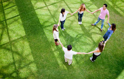 Friends holding hands Stock Images