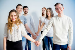 Friends holding hands Stock Photos
