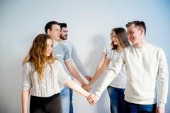 Friends holding hands Royalty Free Stock Photos
