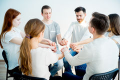 Friends holding hands Stock Photography