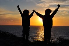 Friends holding by hands Royalty Free Stock Photos