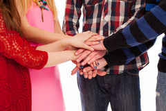 Friends holding hands together Royalty Free Stock Images