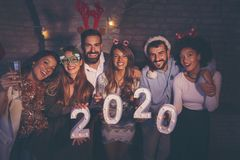 Free Friends Holding Illuminative Numbers 2020 At New Years Party Stock Photos - 165059963