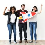 Friends holding a rocket icon stock photography