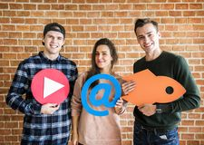 Friends holding up social media and technology concept icons Stock Image