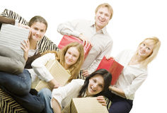 Friends on a holiday. Four girl and boy with gifts isolated Stock Image