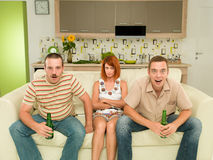Friends at home watching tv Stock Image