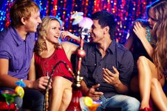 Friends in hookah room Royalty Free Stock Images