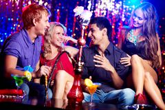 Friends in hookah room Royalty Free Stock Photography
