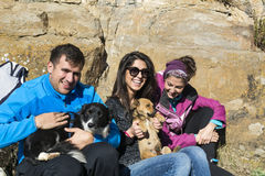 Friends  hugging dogs outdoor. Happy friends   hugging dogs outdoor Stock Images