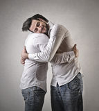 Friends hugging Stock Images