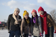 Friends on ice rink Stock Photography