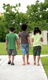 Friends III. Three little kids walking together Royalty Free Stock Photo