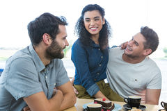 Friends interacting with each other in coffee shop Stock Photo