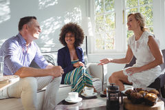 Friends interacting while having breakfast Royalty Free Stock Photos