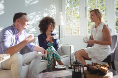 Friends interacting while having coffee Stock Photo