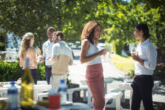 Friends interacting while having glass of wine in restaurant. Happy friends interacting while having glass of wine in restaurant Royalty Free Stock Photography