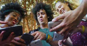 Friends interacting and using mobile phone in park 4k. Happy friends interacting and using mobile phone in park 4k stock footage