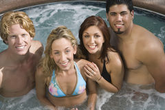 Friends In Jacuzzi Stock Photos