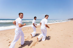 Friends jogging beach Stock Images