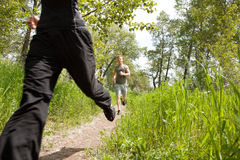 Friends jogging in forest Royalty Free Stock Images