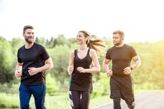 Friends jogging outdoors royalty free stock photos
