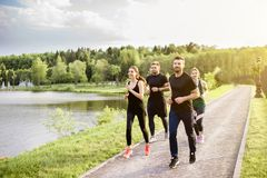Friends jogging outdoors royalty free stock photo